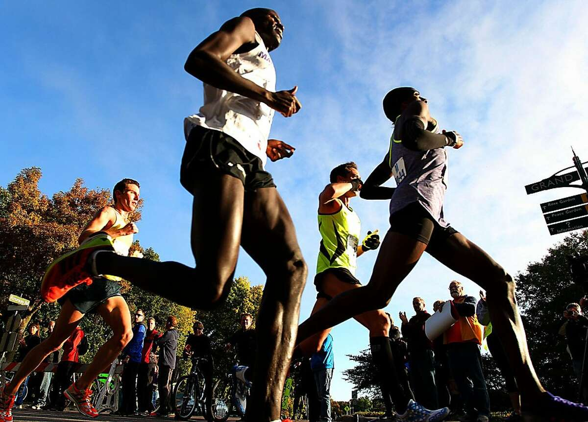Elite Runners race around Lake Harriett during the Medtronic Twin Cities Marathon in Minneapolis, Sunday, Oct. 6, 2013. (AP Photo/Andy Clayton-King)