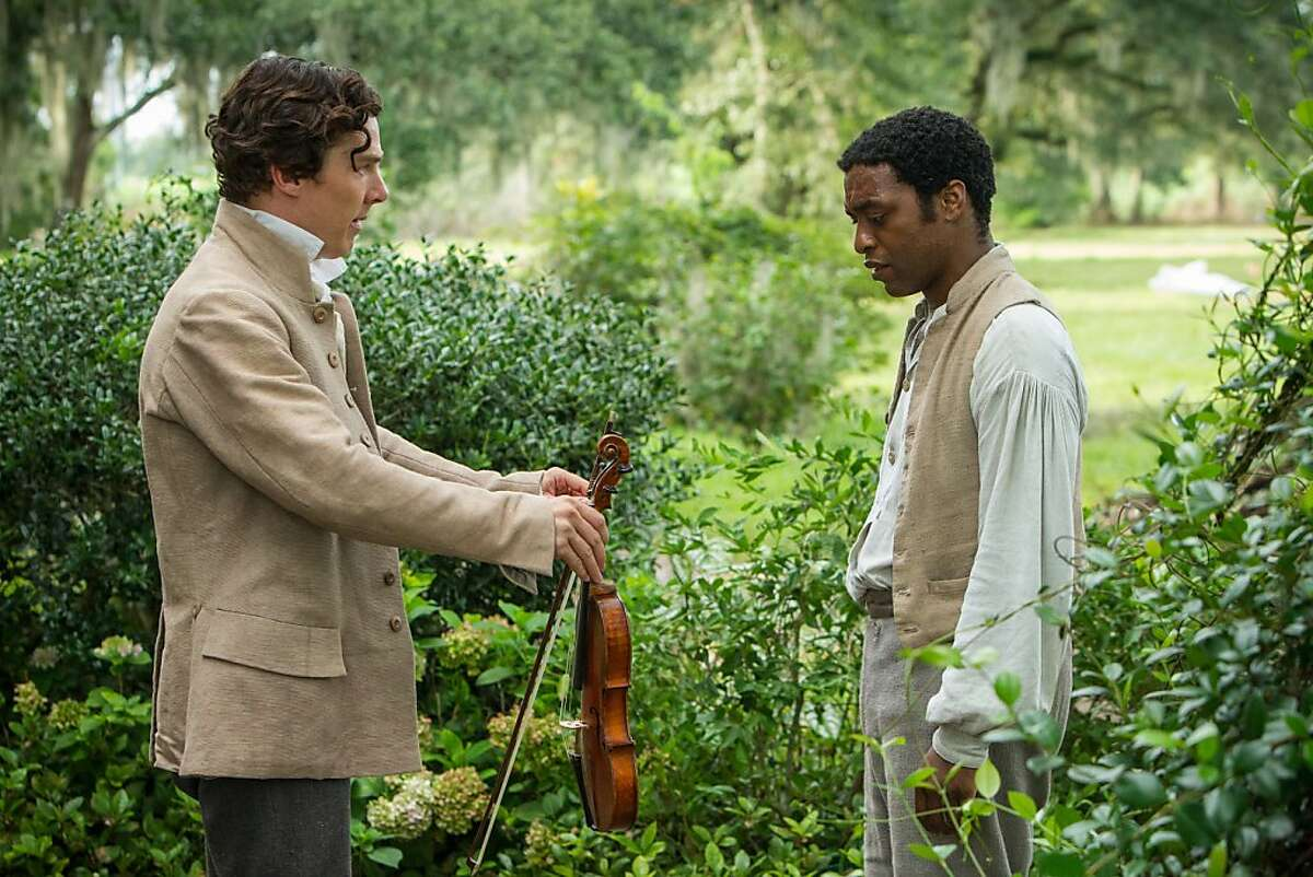 This film publicity image released by Fox Searchlight shows Benedict Cumberbatch, left, and Chiwetel Ejiofor in a scene from