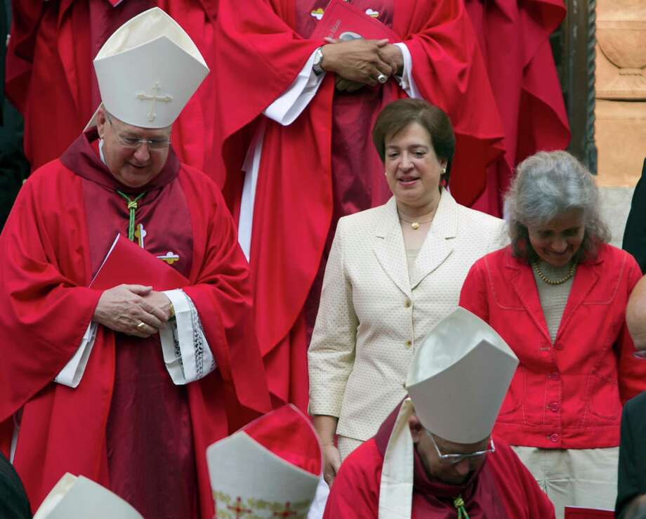 Speaking of church and state, Justice Elena Kagan talks with clergy after the Red Mass at the Cathedral of St. Matthew the Apostle in Washington on Sunday, Oct. 6, 2013. Photo: Jose Luis Magana