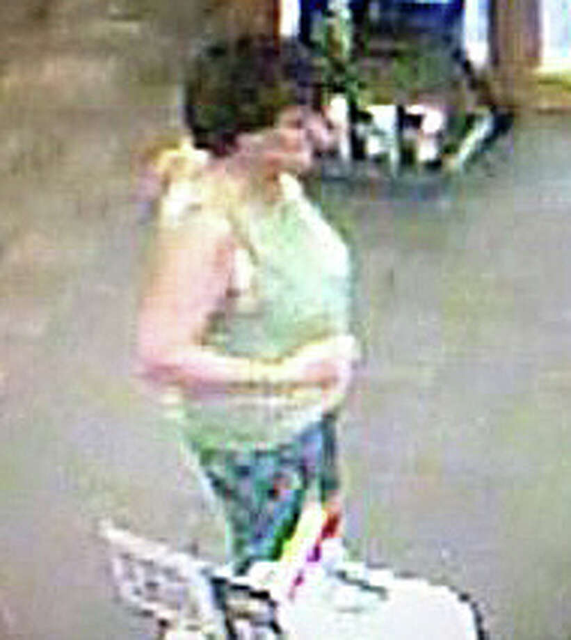 Police are asking the public's help in identifying this woman -- seen here in a suveillance camera image -- wanted in connection for a breach of peace incident Sept. 1 at the Fairfield University Bookstore. Photo: Fairfield Police Department / Fairfield Citizen contributed
