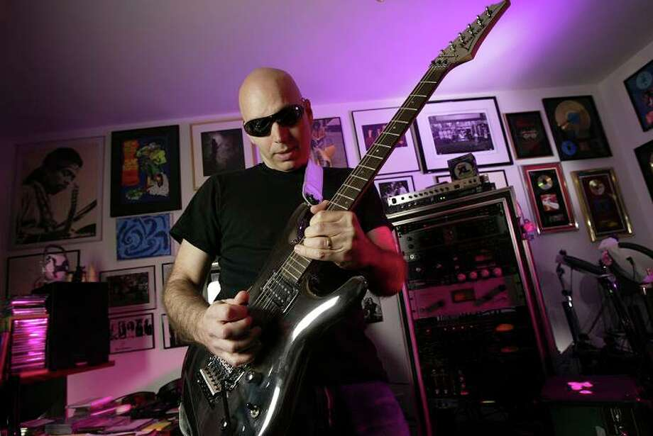JOE SATRIANI, guitar wizard: While his peers were desperately hanging on to their long rocker hair, the SF guitarist was surfing with a straight razor. Photo: Craig Lee, The Chronicle / The Chronicle