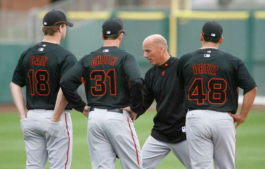 TIM FLANNERY, coach, musician: Whether playing bluegrass or coaching third base for the Giants, Flannery gives the green light to a clean-shaven head. Photo: Deanne Fitzmaurice, Chronicle / San Francisco Chronicle