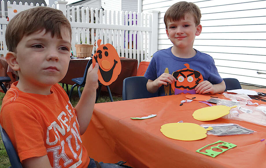 Zach Johnston, 3, of Easton, and his brother Nate, 5, making Halloween-themed crafts at Our Saviour's Hill Farm Fall Festival on Saturday. Photo: Mike Lauterborn / Fairfield Citizen contributed