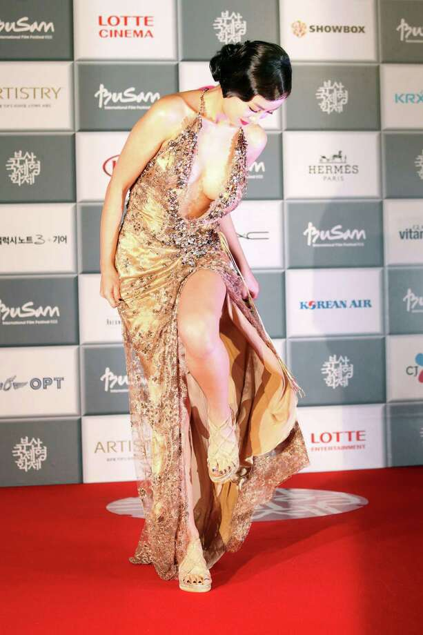 Well, she wasn't intending as much as she showed - but South Korean actress Han Soo Ah just escaped a serious wardrobe malfunction when she arrived to attend the opening ceremony of the Busan International Film Festival at Busan Cinema Center in Busan, south of Seoul, South Korea, Thursday, Oct. 3, 2013. Photo: AP