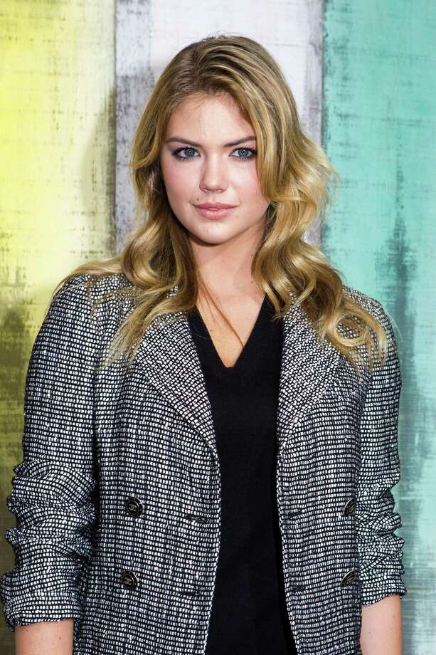 Kate Upton poses for photographers as she arrives to attend the presentation of Chanel's ready-to-wear Spring/Summer 2014 fashion collection, presented Tuesday, Oct. 1, 2013 in Paris. Photo: AP
