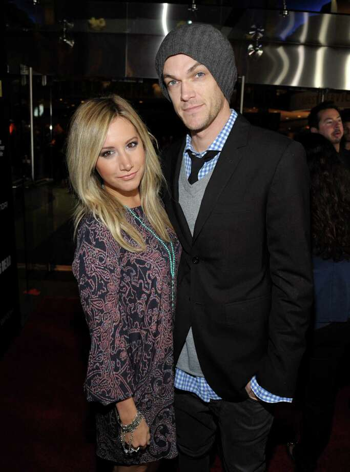 """IMAGE DISTRIBUTED FOR AMC - Ashley Tisdale, left, and Christopher French  attend AMC's season 4 premiere of """"The Walking Dead"""" at the AMC Universal CityWalk Stadium on Thursday, Oct. 3, 2013, in Los Angeles. Photo: AP"""