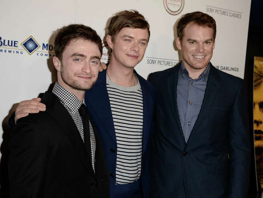 "From left to right, actor Daniel Radcliffe, actor Dane DeHaan, and actor Michael C. Hall arrive at the premiere of the feature film ""Kill Your Darlings"" at the Writers Guild of America Theatre on Thursday, Oct. 3, 2013 in Beverly Hills, Calif. Photo: AP"