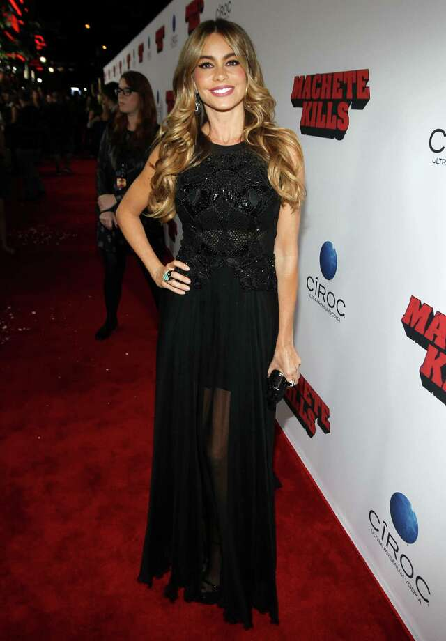 "Sofia Vergara arrives on the red carpet of the premiere of ""Machete Kills"" at the Regal Cinemas LA Live on Wednesday, Oct. 2, 2013 in Los Angeles. Photo: AP"