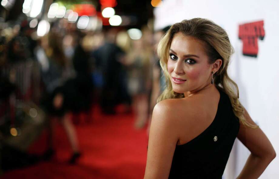 "Alexa Vega arrives on the red carpet of the premiere of ""Machete Kills"" at the Regal Cinemas LA Live on Wednesday, Oct. 2, 2013 in Los Angeles. Photo: AP"