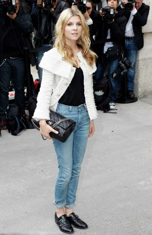 Clemence Poesy arrives to attend the presentation of Chanel's ready-to-wear Spring/Summer 2014 fashion collection, Tuesday, Oct. 1, 2013 in Paris. Photo: AP