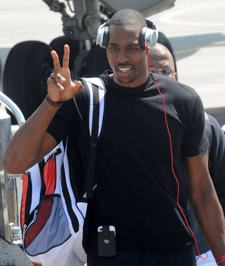 Dwight Howard gestures to fans upon arrival at Manila's International Airport on Monday. Photo: Jay Directo, AFP/Getty Images