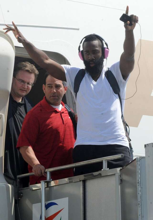 James Harden gestures to fans upon arrival at Manila's International Airport on Monday. Photo: Jay Directo, AFP/Getty Images
