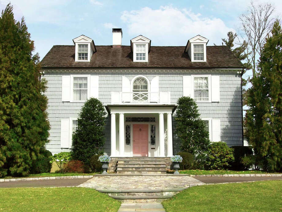 The more than 6,000-square-foot Federal-style house at 25 Saint John Place in New Canaan, on the market for $4,595,000, has combines the charm of the early 20th century with modern amenities. Photo: Contributed