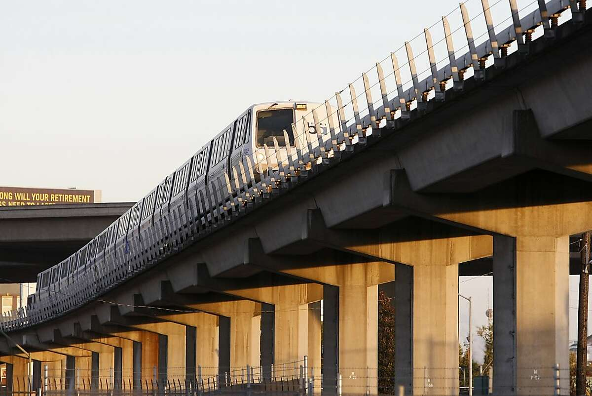 A BART train runs along the elevated track above 7th St. as it heads for San Francisco, in West Oakland, California Wednesday October 2, 2013.