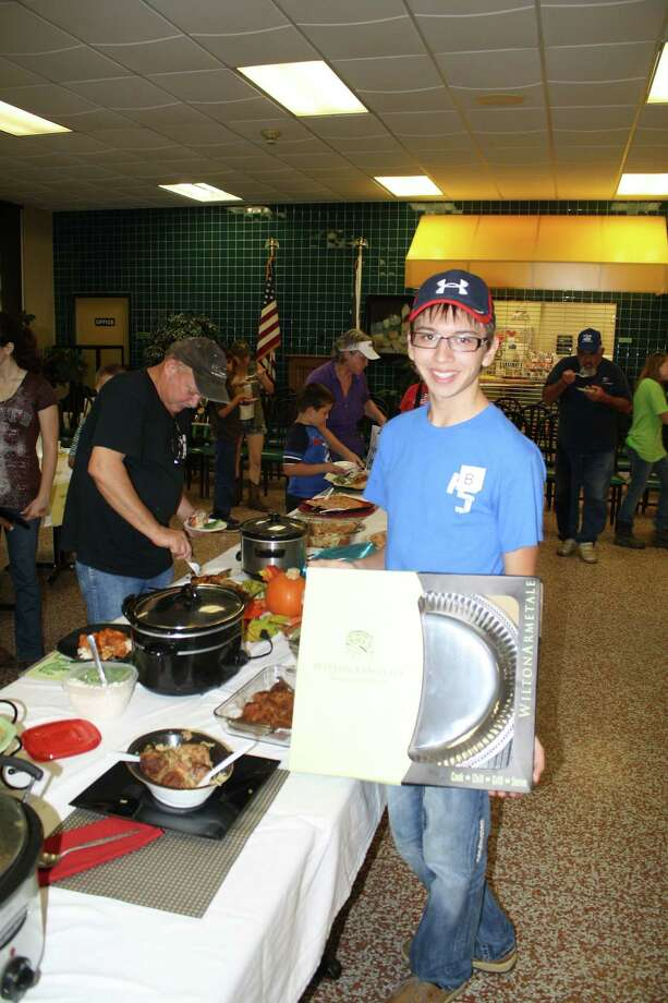 Fifteen-year-old Alex Guajardo, a Hardin-Jefferson High School sophomore, won Grand Champion of the rice cooking festival at the 44th Annual Texas Rice Festival in Winnie for the third consecutive year -- a first in its history. Photo: Jose D. Enriquez III