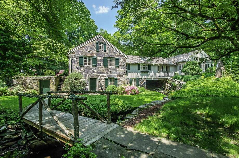 The stone house at 958 Hillside Road is on the market for $2,299,000. Photo: Contributed Photo / Fairfield Citizen contributed