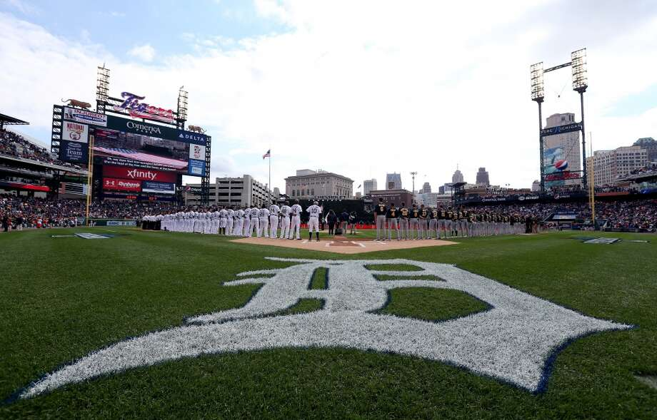 The Detroit Tigers and the Oakland Athletics line up for the national anthem prior to Game Three of the American League Division Series at Comerica Park on October 7, 2013 in Detroit, Michigan. Photo: Rob Carr, Getty Images