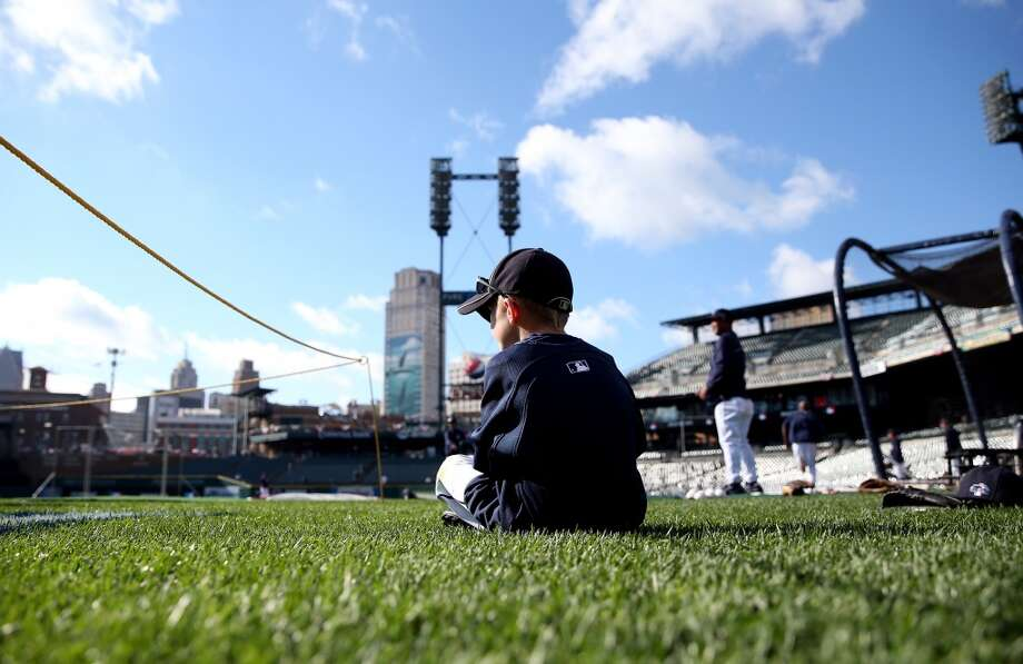 A young Detroit Tigers fan watches batting practice prior to the start of Game Three of the American League Division Series between the Detroit Tigers and the Oakland Athletics  at Comerica Park. Photo: Leon Halip, Getty Images