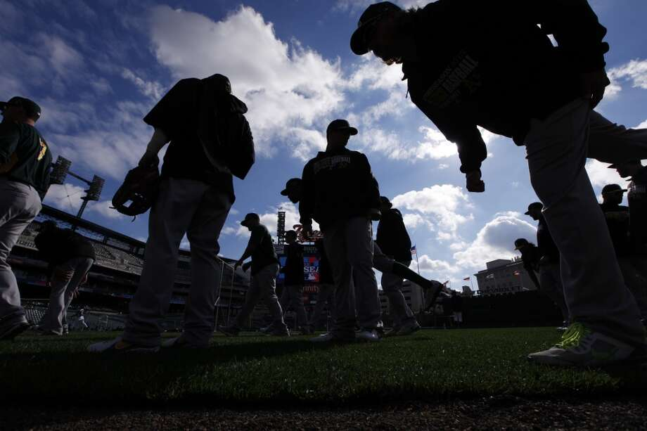 The Oakland Athletics stretch before batting practice for Game 3 of an American League baseball division series against the Detroit Tigers in Detroit, Monday, Oct. 7, 2013. Photo: Paul Sancya, Associated Press