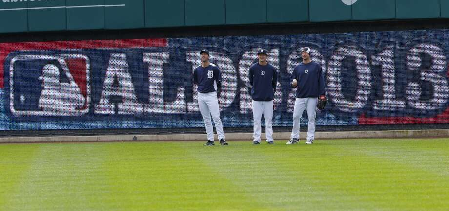 Detroit Tigers pitchers Justin Verlander, left, Drew Smyly, center and Max Scherzer watch batting practice before Game 3 of an American League baseball division series against the Oakland Athletics in Detroit, Monday, Oct. 7, 2013. Photo: Paul Sancya, Associated Press