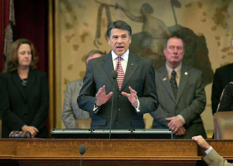 Gov. Rick Perry addresses House legislators at the Capitol in Austin. Perry and state lawmakers were misguided when they failed to embrace Medicaid expansion. Photo: Deborah Cannon, Associated Press / Austin American-Statesman