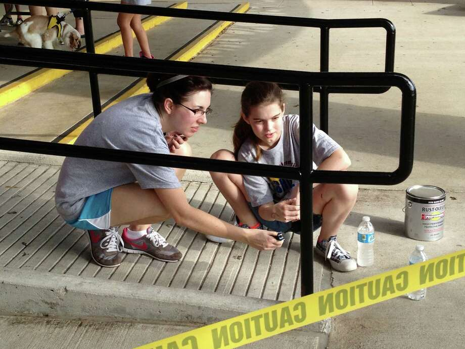 Language Arts teacher Jessica Slaughter and sixth grader Kelsey Maca participated in Seabrook Intermediate School's work day Sept. 28. Photo: Courtesy Of Seabrook Intermediate School