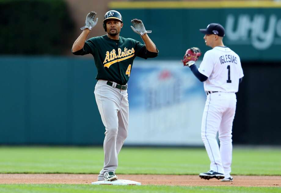 Coco Crisp reacts after hitting a double in the first inning against the Detroit Tigers during Game Three of the American League Division Series at Comerica Park on October 7, 2013 in Detroit, Michigan. Photo: Rob Carr, Getty Images