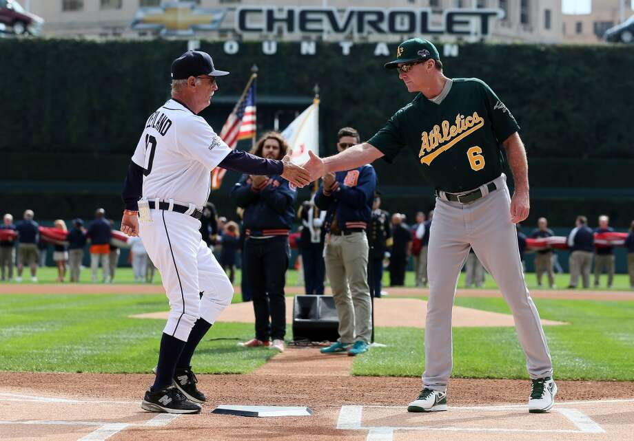 Managers Jim Leyland  of the Detroit Tigers and Bob Melvin of the Oakland Athletics shake hands before the start of Game Three of the American League Division Series at Comerica Park on October 7, 2013 in Detroit, Michigan. Photo: Rob Carr, Getty Images