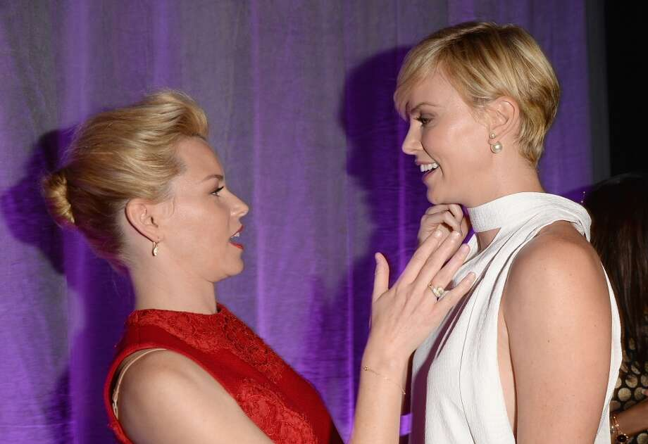 Honorees Elizabeth Banks (L) and Charlize Theron attend Variety's 5th Annual Power of Women event presented by Lifetime at the Beverly Wilshire Four Seasons Hotel on October 4, 2013 in Beverly Hills, California.  (Photo by Jason Merritt/Getty Images for Variety) Photo: Jason Merritt, Getty Images For Variety