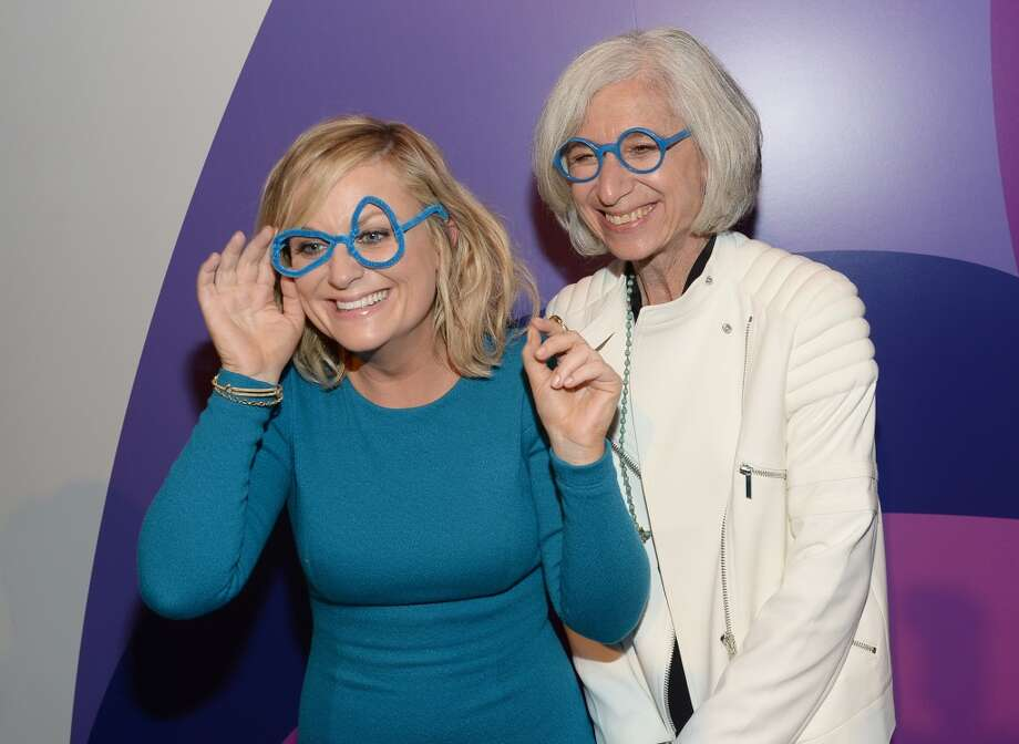 Honoree Amy Poehler (L) and founder of Worldwide Orphans Foundation Dr. Jane Aronson attend Variety's 5th Annual Power of Women event presented by Lifetime at the Beverly Wilshire Four Seasons Hotel on October 4, 2013 in Beverly Hills, California.  (Photo by Michael Buckner/Getty Images for Variety) Photo: Michael Buckner, Getty Images For Variety