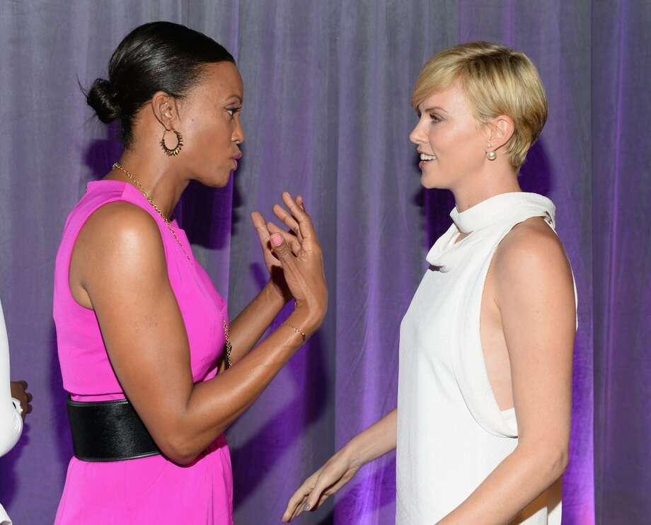 Host Aisha Tyler (L) and honoree Charlize Theron attend Variety's 5th Annual Power of Women event presented by Lifetime at the Beverly Wilshire Four Seasons Hotel on October 4, 2013 in Beverly Hills, California.  (Photo by Michael Kovac/Getty Images for Variety) Photo: Michael Kovac, Getty Images For Variety