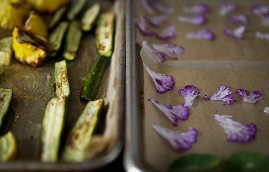 Squash and shaved cauliflower sit in trays at Sweet Woodruff.. Photo: Russell Yip, The Chronicle