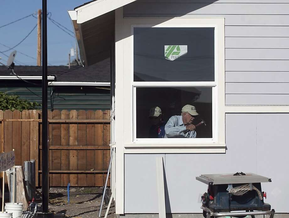 Now 89, former President Jimmy Carter frequently travels across the U.S. to build affordable homes with Habitat for Humanity. Photo: Mike Kepka, The Chronicle