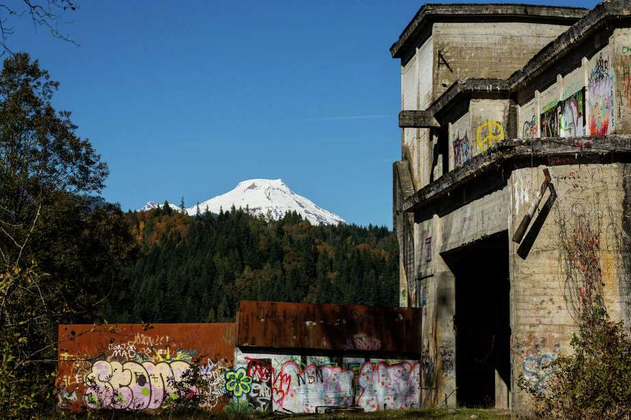 Mount Baker serves as a snow-capped backdrop to an abandoned crusher plant Sunday, Oct. 6, 2013, near Concrete. Photo: JORDAN STEAD / JORDAN STEAD