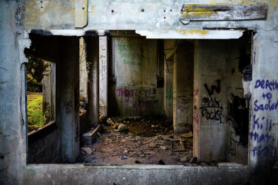 Graffiti adorns the ruined walls of a crusher plant Sunday, Oct. 6, 2013, near Concrete. Photo: JORDAN STEAD / JORDAN STEAD