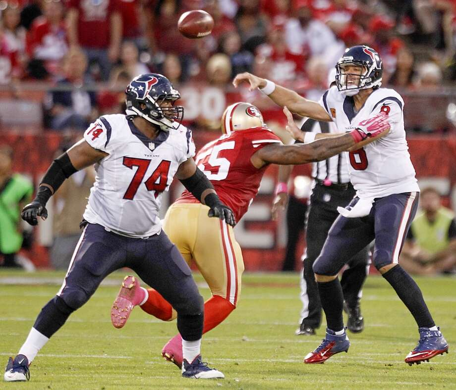 Texans quarterback Matt Schaub gets off a pass as 49ers outside linebacker Ahmad Brooks applies pressure and guard Wade Smith (74) looks on during the second quarter. Photo: Brett Coomer, Houston Chronicle
