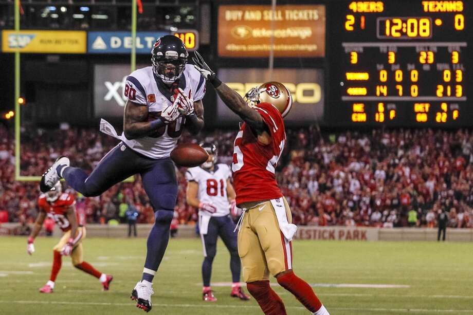 Texans wide receiver Andre Johnson can't hold on to a pass as 49ers cornerback Tarell Brown defends during the third quarter. Photo: Brett Coomer, Houston Chronicle
