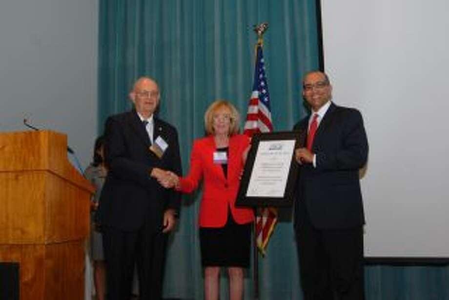 Among those attending the luncheon were Burton Hering, from left, Mary Jackson and Charles Dupre. Photo: Photo By Executive Service Corps Of Houston