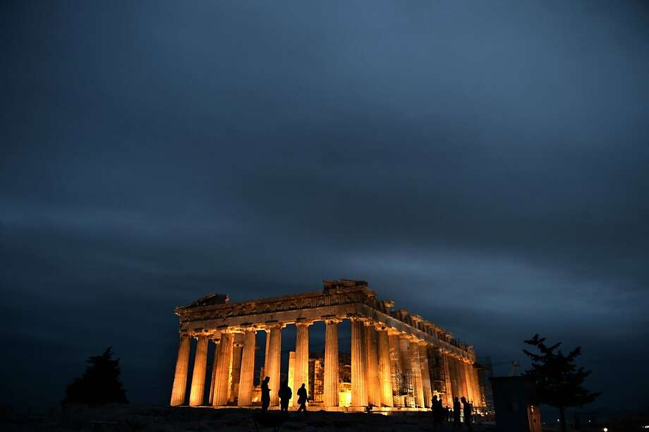The Parthenon glows atop the Acropolis as evening falls in Athens. Photo: Aris Messinis, AFP/Getty Images