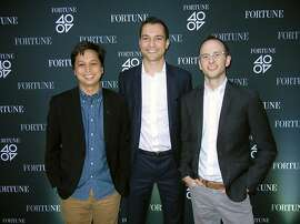 "Pinterest co-founder Ben Silbermann (at left) with Airbnb co-founders Nathan Blecharczyk and Joe Gebbia at Airbnb HQ for Fortune Magazine's ""40 Under 40"" party. Oct 2013. By Catherine Bigelow"