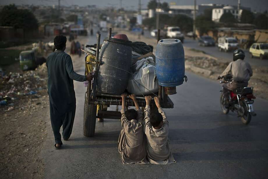Wanna drag? Hitching a ride with a donkey cart in Islamabad calls for trousers with reinforced seats. Photo: Muhammed Muheisen, Associated Press