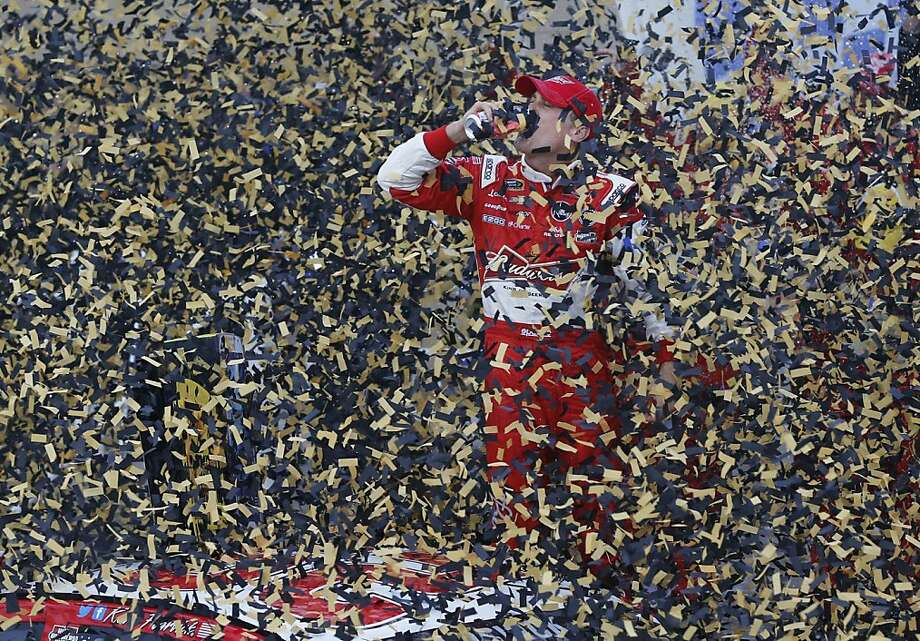 Showered with confetti, Kevin Harvick celebrates after winning a NASCAR race at Kansas Speedway in Kansas City, Kan. Photo: Orlin Wagner, Associated Press