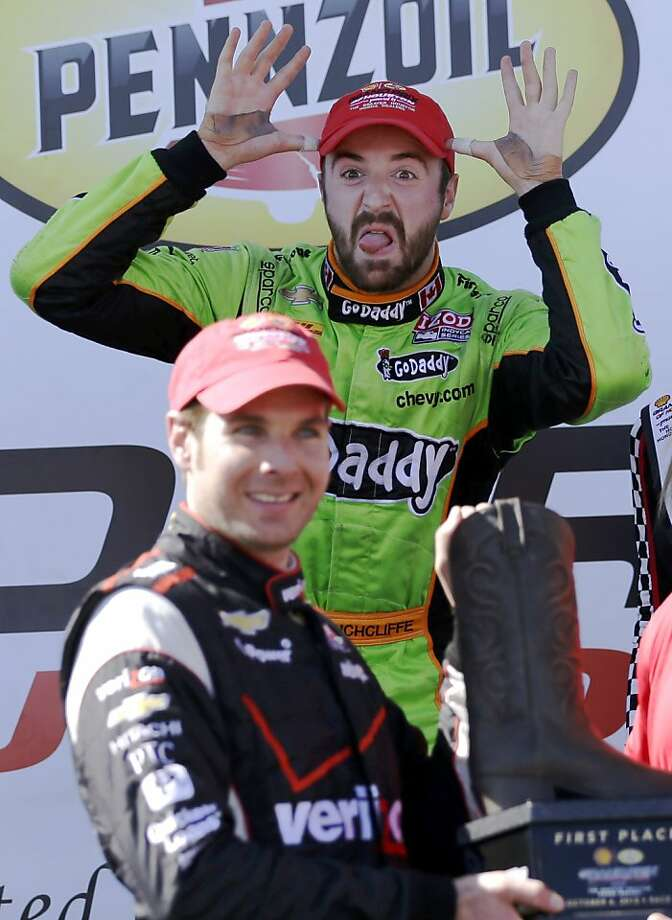 There's nothing worse than a sore loser: Third-place finisher James Hinchcliffe photobombs Will Power, 
