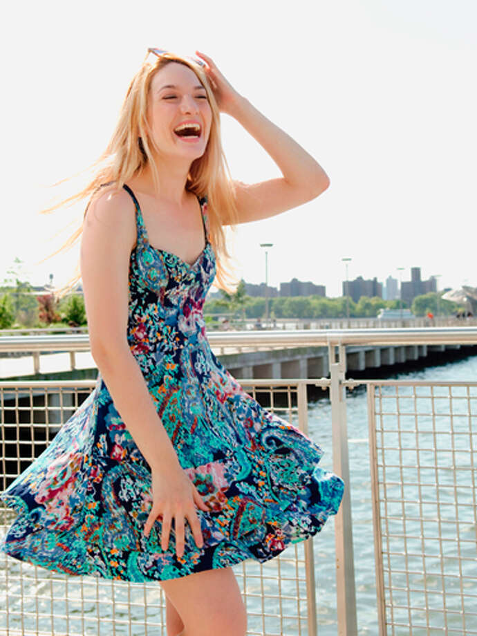 """Skip casual Friday""""I have a dress that I borrowed from my roommate back when I was 22 — and never gave back,"""" says Kristin R., 30, of Seacaucus, NJ. """"Now, when I wear it, I feel like it's easier to connect with the younger, more energetic version of myself."""" While slipping on a favorite item of clothing from a former era of your life may make you feel young, it might also ward off depression — a recent study found that wearing jeans could make you feel depressed. So skip your skinnies and pull on a slightly dressier outfit for an instant mood boost.25 Little Things He Loves About YouTop 50 Date-Night Ideas of All Time50 Simple Little Ways to Feel Sexy50 Knockout Date-Night Hairstyles40 No-Fail Beauty Shortcuts Photo: Getty Images / (c) Image Source"""