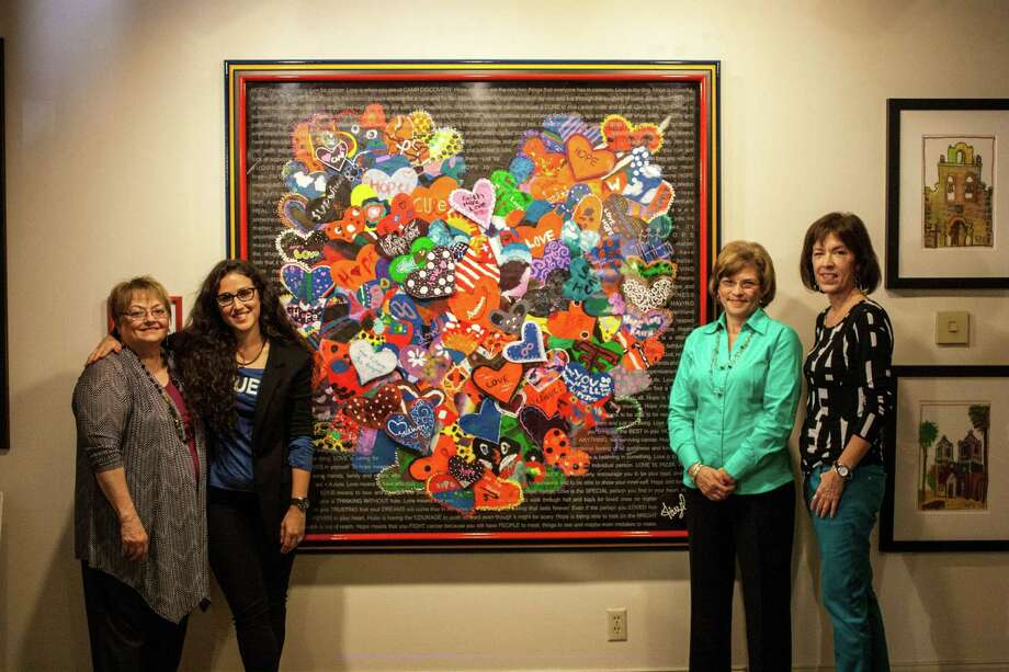 Cathie Clark (from left) of Art Incorporated, artist Faryl Greller, ACS volunteer Vicki Goebel and graphic artist Janice Boatright flank a mural made with 150 canvas hearts. Photo: Courtesy Sharkmatic Advertising