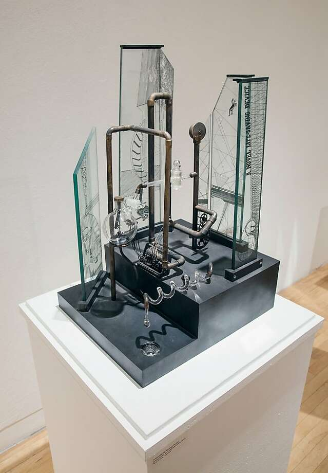 """A Novel Life-Saving Device"" is a 2012 piece of mixed metals and glass. ""Machines bamboozle me,"" artist Bella Feldman says. Photo: John Wehrle"