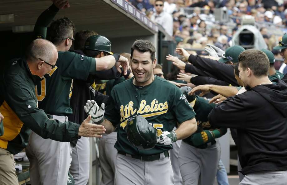 Oakland Athletics designated hitter Seth Smith is congratulated after his solo home run in the fifth inning of Game 3 of the ALDS. Photo: Carlos Osorio, Associated Press