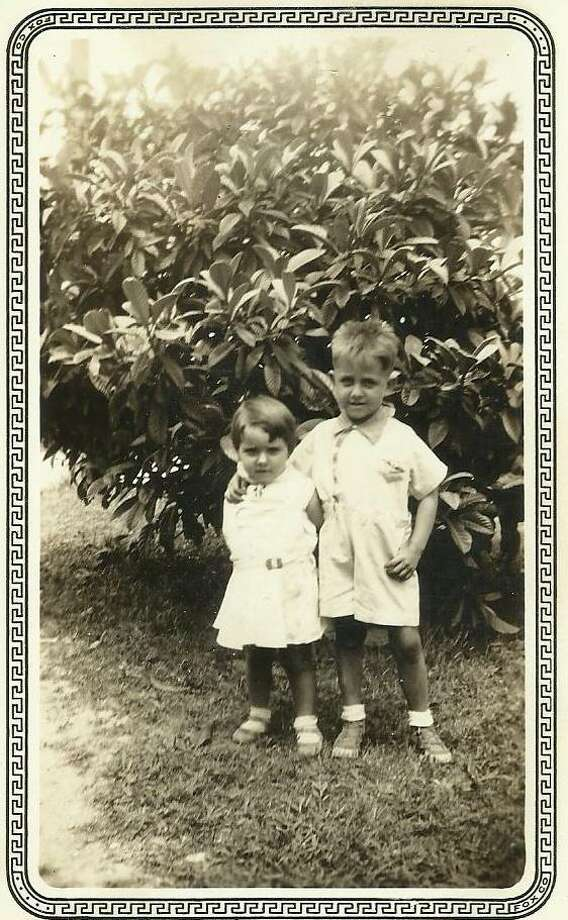 Then: The Bongiovi siblings, Johnny, 6, and Marie, 4, stand in the yard of their home on Theo Street in 1993. This photo was always one of their mother's favorites according to Marie. Photo: Bongiovi, Reader Submission