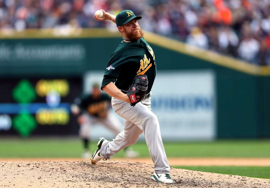 Sean Doolittle pitches in the eighth inning against the Detroit Tigers. Photo: Rob Carr, Getty Images