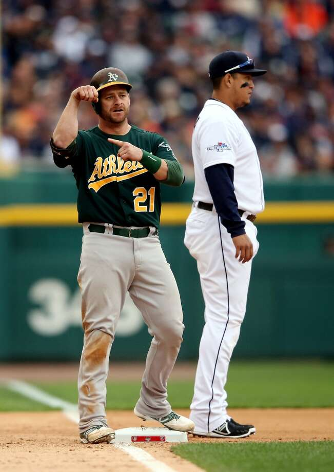 Stephen Vogt reacts after hitting a triple against the Detroit Tigers . Photo: Leon Halip, Getty Images
